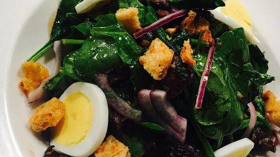 Spinach salad with onion and egg at Central Michel Richard