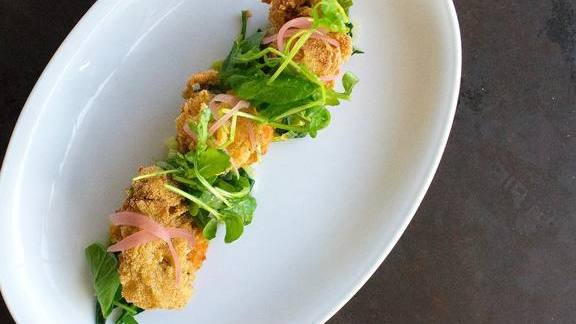 Crispy Gulf Oysters, lobster cake, greens, pickled onion, caper remoulade at Brasserie 19