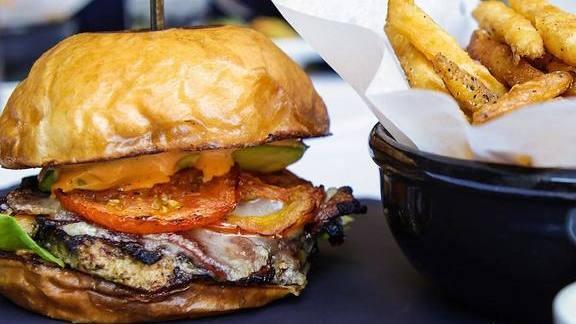 Jerk Chicken Sandwich and fries at Hubbell & Hudson Bistro