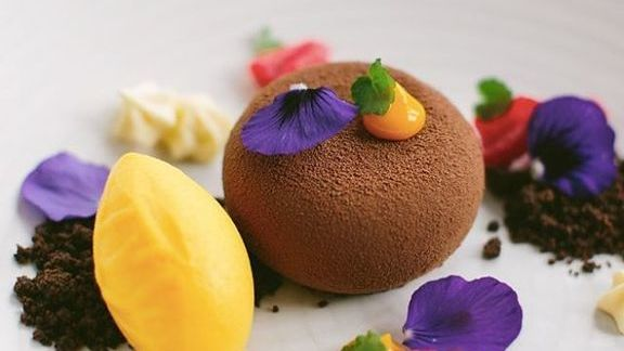 Chef Nico Schuermans reviews Salted chocolate pot de creme, 64% chocolate mousse, chocolate soil, mango puffs, mango sorbet at
