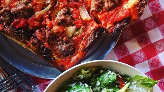 Meat pizza and salad at Square Pie