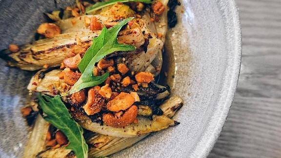 Wood oven-roasted endive with sumac, honey, orange and cashew at Otium