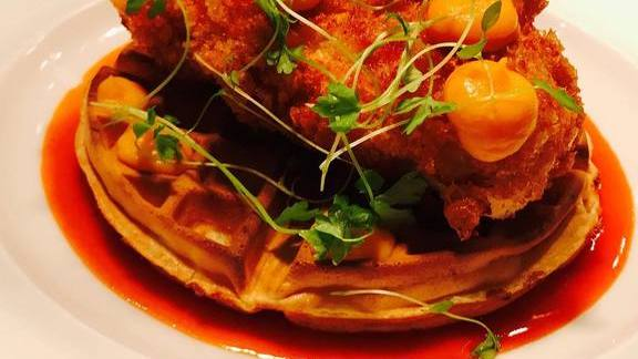 Chicken and waffles with sweet potatoes and Sriracha  at Central Michel Richard