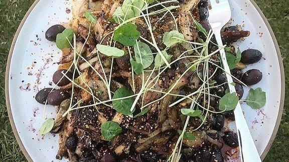 Grilled treviso, roasted grapes, dates, nasturtium, rad el hanout, quail at Wolf
