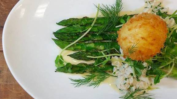 Asparagus with crab, herbs, shoots, and egg at Farm Shed Dinners