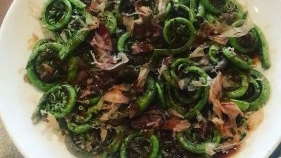 Wok-charred fiddleheads with bacon oyster sauce and bonito at Myers + Chang