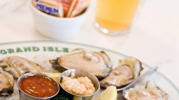 Fresh raw oysters and draft beer at Grand Isle Restaurant