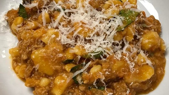 Pork bolognese and parmesan cheese at The 404 Kitchen