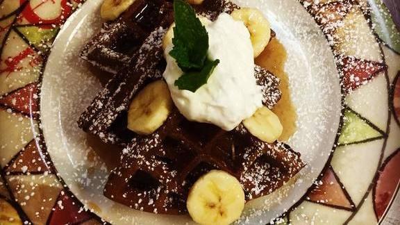 Yogurt chocolate waffle, citrus-banana syrup, whipped yogurt at Cuba Libre Restaurant & Rum Bar