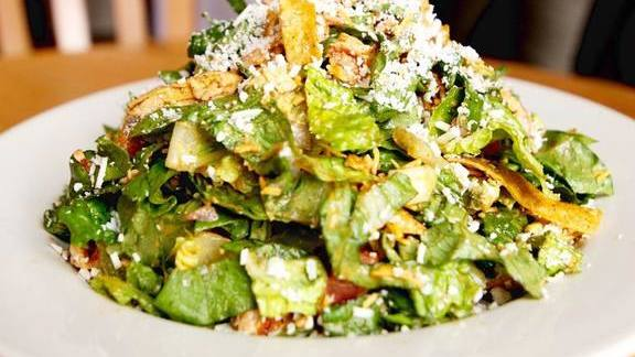 Chef Lisa Schroeder reviews Salad with chicken, tomatoes, red onion, avocado, cheddar, tortilla strips, honey-lime vinaigrette, and cotija cheese at Mother's Bistro & Bar