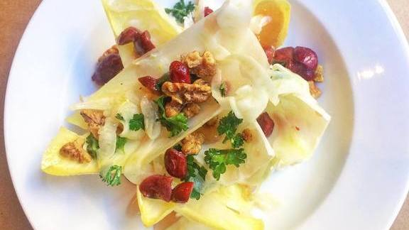 White Belgian endive salad, honey vinaigrette, fresh cheese and fennel walnuts at Little Bird Bistro