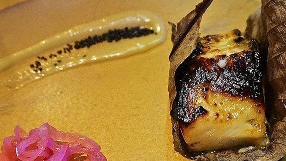 Chef Kimberly Bugler reviews Yuzu marinated black cod in Japanese Magnolia leaf at Roka Akor