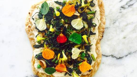 Chef Scott Winegard reviews Nettle and asparagus flatbread at Plant Food + Wine Miami
