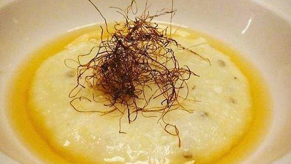 Chef Rico Torres reviews Corn silk and smoked pasilla broth at Mixtli