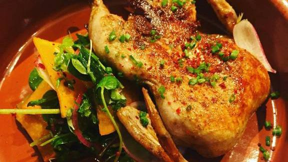 Chef Stephen Marcaurelle reviews Quail escabeche with Sichuan pickled persimmon, fragrant herbs and Arbol chili at Tres Gatos