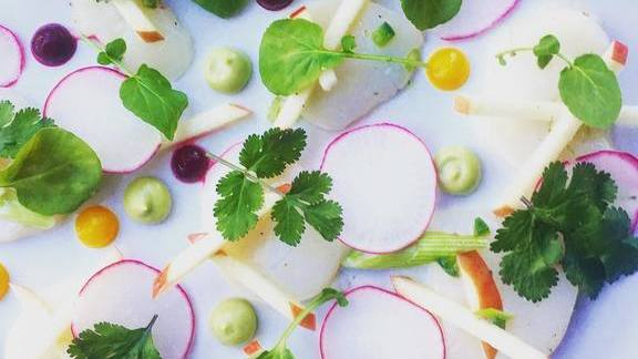 Chef Sean Fowler reviews Scallop crudo with radishes, jalapeños, pink lady apples, cilantro, watercress at Mandolin