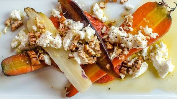 Warm heirloom carrots, harissa, local ricotta and pecans at Coltivare Pizza & Garden