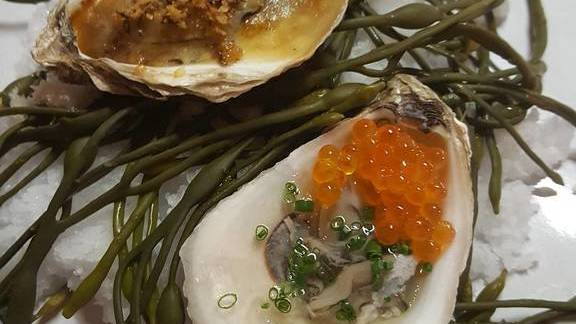 Oyster, champagne gelee, trout roe (party). Baked oyster, trotter jus, gruyere, rye crumbs (french onion soup) at Cure