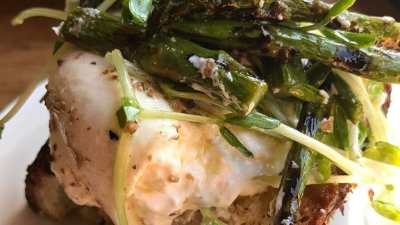 Burrata and black truffle vinaigrette, asparagus, pea shoots on Filone toast at Frankies 457