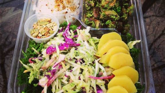 Chef Leanne Valenti reviews Bento lunch with rice, slaw and vegetables at BENTO + PICNIC