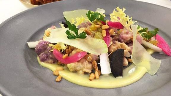 Cauliflower and chickpea salad with olives, caroline lettuce, pickled red onions, sultanas and curry vinaigrette at ad hoc