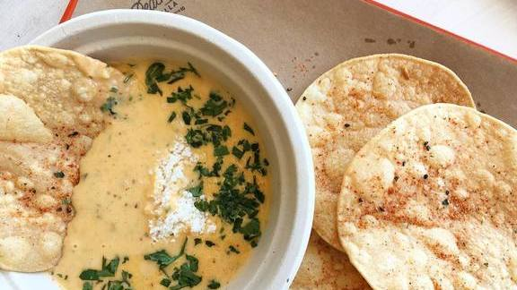 Chef Eric Silverstein reviews Kimchi queso at The Peached Tortilla