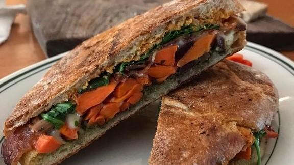 Sandwich with carrots, arugula, pesto, and cheese at Cheese Bar