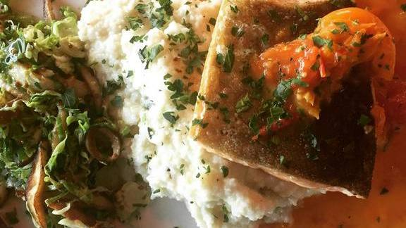 Chef Doug Levy reviews pan-seated Arctic char  at Feast