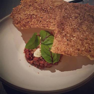 Lamb tartare with green harrisa mint and chickpea crackers at Acacia House by Chris Cosentino
