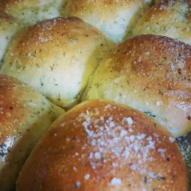 Bread rolls with cottage cheese and dill at Cafe Margot