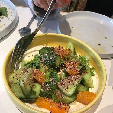 Cucumbers, orange segments, cilantro, yogurt and black pepper at Kismet