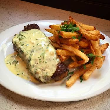 NY strip steak with french fries at Chez Nous
