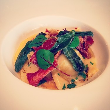 Pork ravioli with squash purée, sorghum, butter, ham, sage, and sorrel at Oak Steakhouse