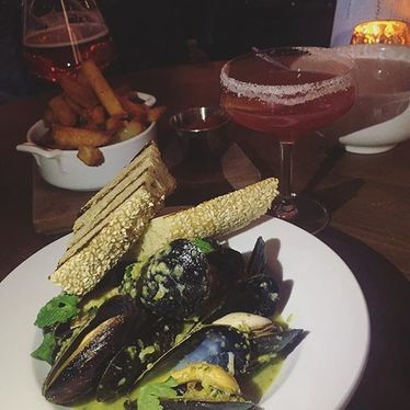Buxton boat mussels, poblano coconut & grilled sesame baguette at The Kitchen