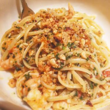 Rock shrimp linguini, pickle garlic, campari tomatoes, marcona almond, meyer lemon and herb at Upland