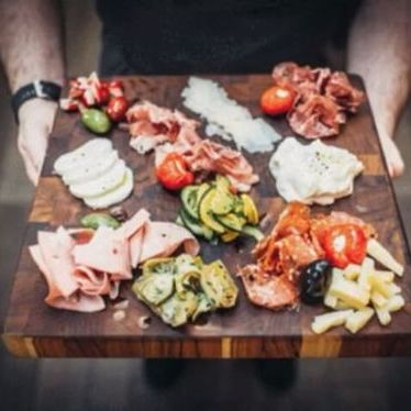 Artisanal salumi, cheeses, marinated market vegetables and housemade breads at Cucina by Wolfgang Puck