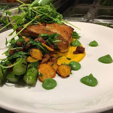 Pan roasted mahi mahi, crispy pancetta, grilled asparagus, arugula, English pea and herb puree, carrot-coconut sauce at Foundry On Elm