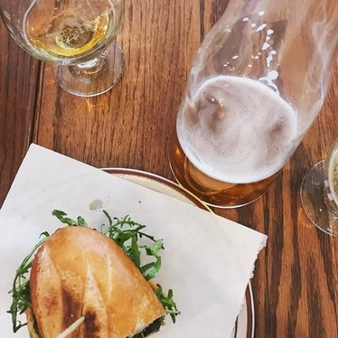 Craft beer and chorizo fig cheese sandwich at Provisions Market