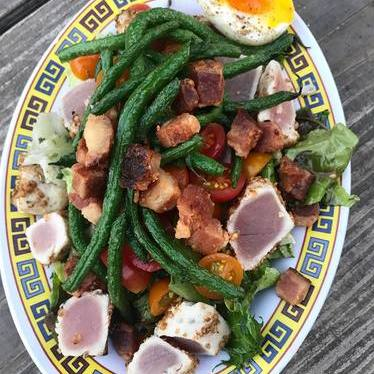 Bacon nicoise and coriander crusted tuna with fried haricot vert and tomatoes at Sunday Dinner Club