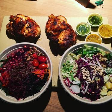 Rotisserie chicken, vegetables and greens at FLOCK Rotisserie + Greens