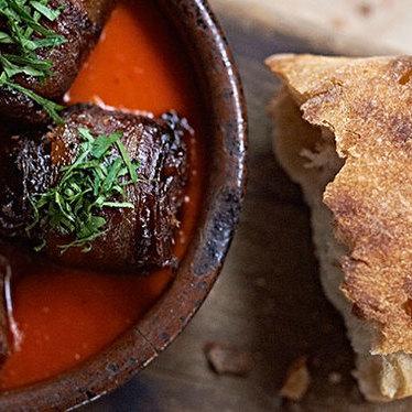 Chorizo-stuffed medjool dates at Avec