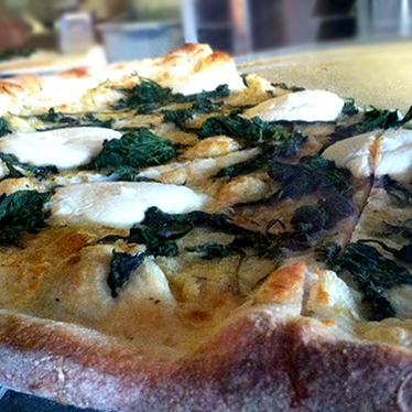 White clam pizza at Home Slice Pizza