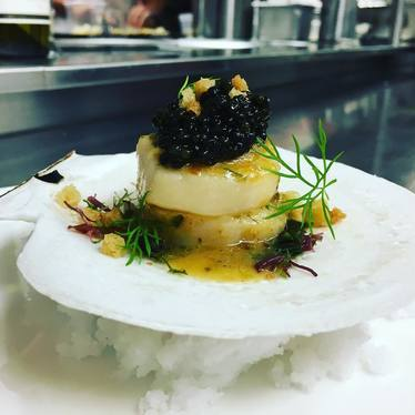 Roasted scallop, siberian caviar, seaweed-lime butter, brioche croutons at MINA Test Kitchen