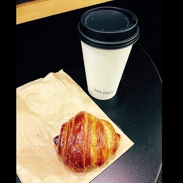 Croissant and coffee at Rival Bros. Coffee