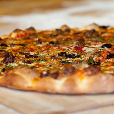 Garlic sautéed mushroom & pancetta pizza at Pizza Delicious