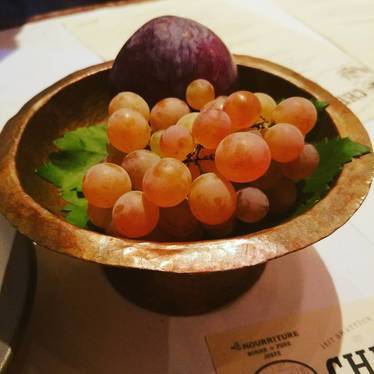 Fruit bowl with grapes and plum at Chez Panisse