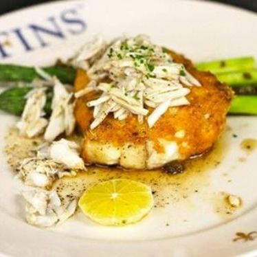 Parmesan crusted flounder with lemon and asparagus at GW Fins