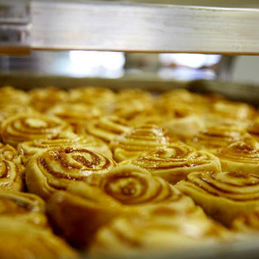 Cinnamon rolls at Knaus Berry bakery line