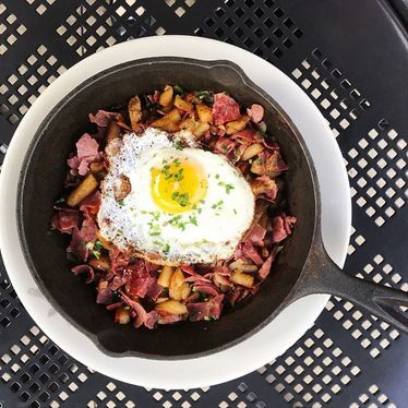 Corned beef hash with fried egg at Bantam + Biddy