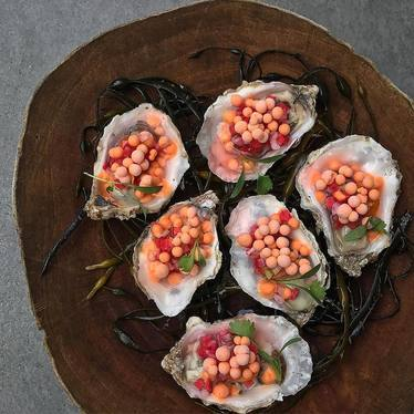 Oysters with pico de gallo mignonette and Cholula ice cream pearls at Juniper & Ivy